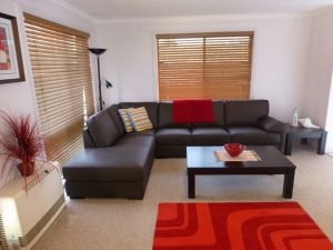 Relax in the lounge room at Ocean Grove Holiday House